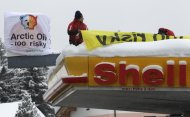 Greenpeace protesters shut down a Shell petrol station during the annual meeting of the World Economic Forum (WEF) in Davos-Wolfgang January 25, 2013. REUTERS/Denis Balibouse (SWITZERLAND - Tags: BUSINESS POLITICS CIVIL UNREST ENERGY ENVIRONMENT)