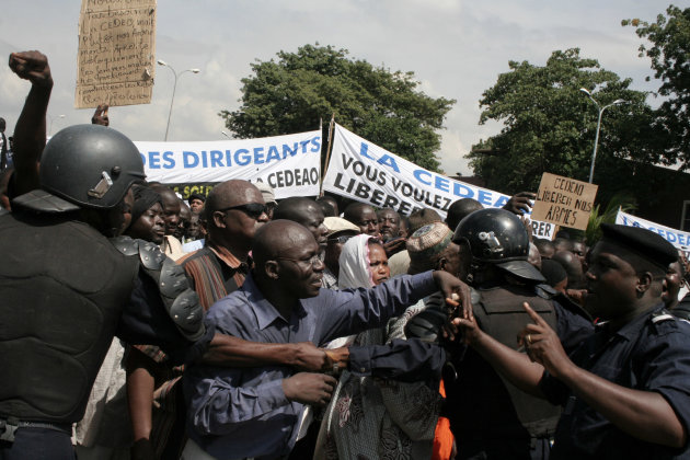 FILE - In this Thursday, Oct. 18, 2012 file photo, Malians opposing a foreign military intervention to retake Mali's Islamist-held north clash with police as they march in the streets of the capital, Bamako, Mali. Nigerian state-run TV says a bloc of West African nations has agreed to send 3,000 troops to stabilize Mali. The decision came late Sunday, Nov. 11, 2012, at the end of an emergency ECOWAS bloc summit in Nigeria's capital. Military experts from the U.N., ECOWAS, Europe and the African Union have drafted a plan to recapture northern Mali from militants, but it would need final approval from the African Union and the U.N. Security Council before it could be carried out. (AP Photo/Harouna Traore, File)