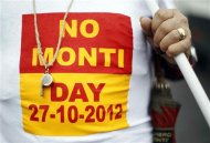 A man wearing a 'No Monti Day' T-shirt attends a demonstration against government austerity policies mounted by a range of protesters from communists to academics in downtown Rome October 27, 2012. REUTERS/Alessandro Bianchi