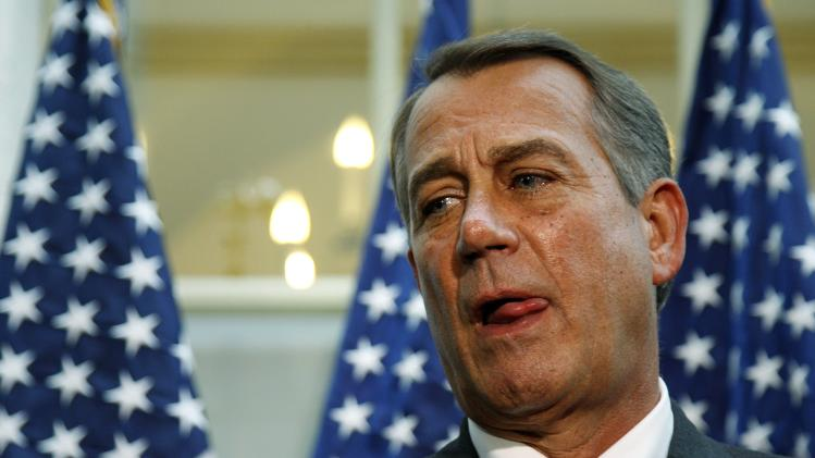 Boehner pauses between answers to questions during a news conference at the U.S. Capitol in Washington
