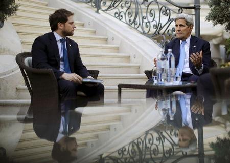 U.S. Secretary of State John Kerry talks to State Department Chief of Staff Jon Finer during a meeting with members of the U.S. delegation at the...