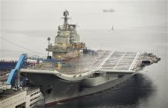 China's first aircraft carrier, which was renovated from an old aircraft carrier that China bought from Ukraine in 1998, is seen docked at Dalian Port, in Dalian, Liaoning province in this September 22, 2012 file photo. China's first aircraft carrier, the Liaoning, officially entered naval ranks on September 25, 2012 the country's Ministry of Defence announced, in a move that it said would help project maritime power and defend Chinese territory. REUTERS/Stringer/Files