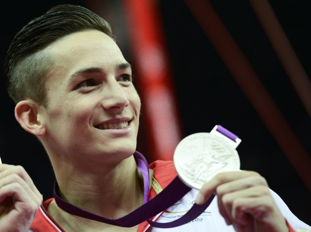Silver medallist Marcel Nguyen of Germany shows off his medal during a ceremony after the men's individual all-around gymnastics final in the North Greenwich Arena during the London 2012 Olympic G