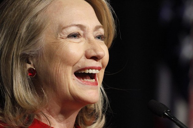 FILE - In this Feb. 14, 2013 file photo, former Secretary of State Hillary Rodham Clinton laughs as she gives a speech during a ceremony honoring her at the Pentagon in Washington. Clinton was honored with the 2013 Helen Keller Humanitarian Award from Helen Keller International in New York on Wednesday, May 22, 2013. (AP Photo/Jacquelyn Martin, File)