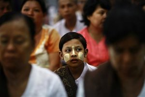 A girl sits among people attending the introduction…