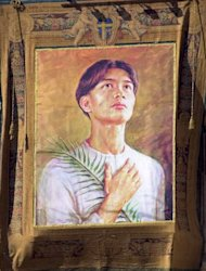 A poster depicting Pedro Calungsod hangs on the facade of St. Peter's square at the Vatican during the ceremony of beatification of 44 martyrs led by Pope John Paul II, Sunday, March 5 2000. The Pontiff proclaimed the beatification of Pedro Calungsod, a Filipino who was killed at the age of 17 during a 1672 expedition by Spanish Jesuit missionaries on Guam. (AP Photo/Massimo Sambucetti)