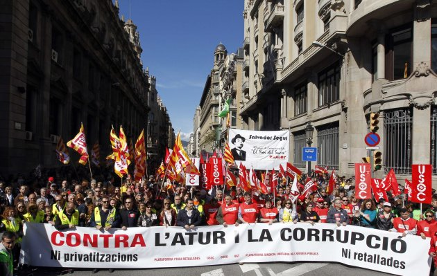 "People hold banners and placards as they march during a protest against government austerity measures in Barcelona March 10, 2013. The banner reads ""Against unemployment and corruption"". REUTERS/Albert Gea (SPAIN - Tags: CIVIL UNREST BUSINESS EMPLOYMENT POLITICS)"