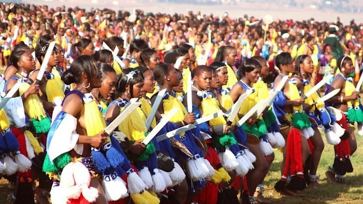 Unmarried Swazi women dance for King Mswati III at the annual Reed Dance near Mbabane, August 29, 2011
