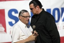 Maricopa County Sheriff Arpaio is introduced by actor Seagal during a campaign rally in Mesa