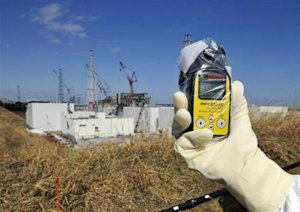 A radiation monitor indicates 131.00 microsieverts per hour at TEPCO's Fukushima Daiichi nuclear power plant in Fukushima