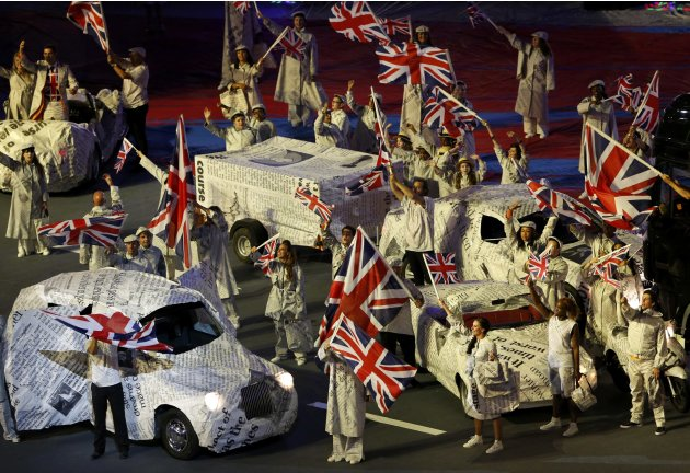 Performers wave Union Jack flags during the closing ceremony of the London 2012 Olympic Games at the Olympic Stadium