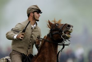 A mounted Confederate reenactor takes part in a demonstration …