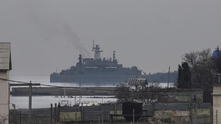 "The Russian naval landing vessel ""Georgiy Pobedonosets"" enters one of the bays of Sevastopol, Sunday, March 2, 2014. Russian President Vladimir Putin has defied calls from the West to pull back his troops, insisting that Russia has a right to protect its interests and the Russian-speaking population in Crimea and elsewhere in Ukraine.(AP Photo/Andrew Lubimov)"