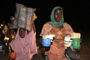 A woman and a child rescued by Nigerian soldiers from…
