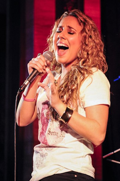 "IMAGE DISTRIBUTED FOR HARD ROCK - Haley Reinhart, who placed third in the tenth season of ""American Idol"" performs at the Under 40 Music Marathon as part of Hard Rock's 12th Annual PINKTOBER breast cancer awareness campaign at Hard Rock Cafe, on Friday, Sept. 28, 2012, in Washington. (Invision for Hard Rock/AP Images)"