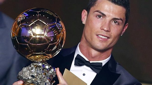 Portugal's Cristiano Ronaldo holds his trophy (Reuters)
