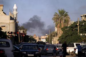 Smoke billows during clashes between security forces …