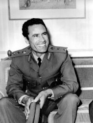 FILE - This undated photo shows Libyan leader Moammar Gadhafi. A U.S. official says Libya's new government has told the United States that Gadhafi, 69, is dead. The official said Libya's Transitional National Council informed U.S. officials in Libya of the development Thursday, Oct. 20, 2011. His death on Thursday, confirmed by Prime Minister Mahmoud Jibril, came as Libyan fighters defeated Gadhafi's last holdouts in his hometown of Sirte, the last major site of resistance in the country. (AP Photo/File)