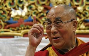 The Dalai Lama gestures during a public talk and teachings event at St. Jakobshalle, in Basel