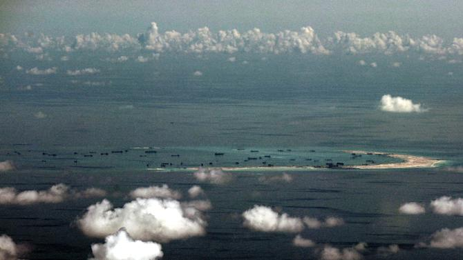 This aerial photograph taken from a military aircraft shows alleged on-going reclamation by China on Mischief Reef in the Spratly group of islands in the South China Sea, west of Palawan, on May 11, 2015