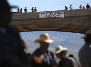 Protesters place a sign on a bridge near the Bureau …