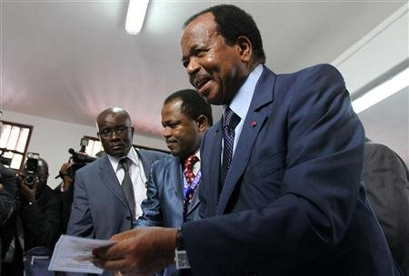 Cameroon's President Paul Biya holds a ballot paper before casting his vote at a polling centre in the capital Yaounde October 9, 2011. REUTERS/Akintunde Akinleye