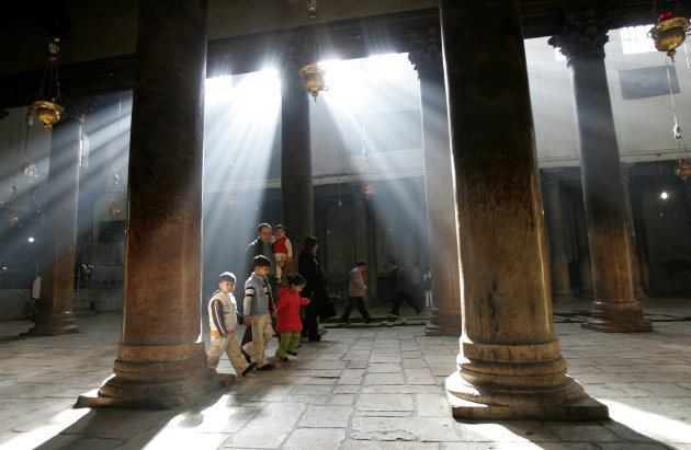 A file photo shows visitors walking through the Church of Nativity in Bethlehem