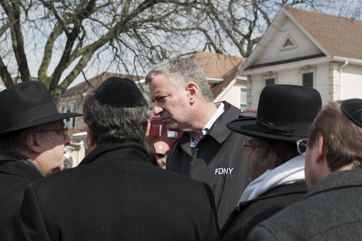 New York Mayor Bill de Blasio speaks to community members after arriving to the site of a home fire in the Midwood neighborhood of Brooklyn, New York