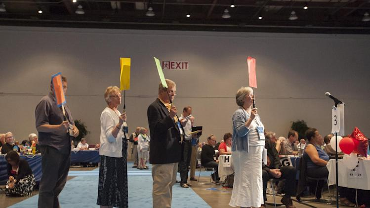 """Commissioners and advisors wait in line to debate a vote on whether the church should recognize same-sex marriage at the 221st General Assembly of the Presbyterian Church at Cobo Hall, in Detroit, Thursday, June 19, 2014. The top legislative body of the Presbyterian Church (U.S.A.) voted by large margins to recognize same-sex marriage as Christian in the church constitution, adding language that marriage can be the union of """"two people,"""" not just """"a man and a woman."""" (AP Photo/The Detroit News, David Guralnick)"""