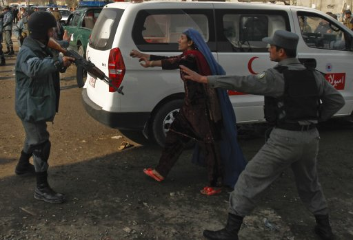 An Afghan woman mourns after a suicide attack at a Shi'ite Muslim gathering in Kabul