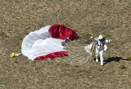 Handout photo of pilot Felix Baumgartner of Austria celebrating after successfully completing the final manned flight for Red Bull Stratos in Roswell