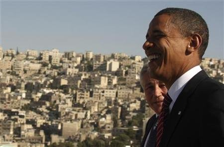 US Democratic presidential candidate Senator Obama (D-IL) shares laugh with Senator Hagel (R-NE) at Amman Citadel in Amman