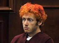 Colorado shooting suspect James Eagan Holmes makes his first court appearance in Aurora, Colorado, July 23, 2012. REUTERS/RJ Sangosti/Pool