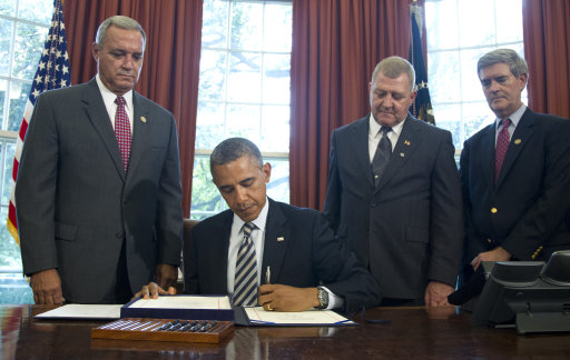 Obama signs bill for Camp Lejeune water victims