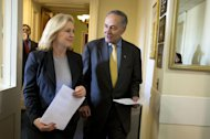 "FILE - In this Jan. 4, 2013, file photo, Sen. Charles Schumer, D-N.Y., right, accompanied by Sen. Kirsten Gillibrand, D-N.Y, enter a news conference on Capitol Hill in Washington, to discuss Superstorm Sandy aid. Conservatives and watchdog groups are mounting a ""not-so-fast"" campaign against a $50.7 billion Superstorm Sandy aid package that Northeastern governors and lawmakers hope to push through the House the week of Jan. 14, 2013. Their complaint is that lots of that money actually will go toward recovery efforts for past disasters and other projects unrelated to the late-October storm. The measure bill includes $150 million for what the Commerce Department described as fisheries disasters in Alaska, Mississippi and the Northeast, and $50 million in subsidies for replanting trees on private land damaged by wildfires. (AP Photo/Jacquelyn Martin)"