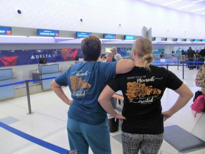 Showing off our cool shirts at the airport