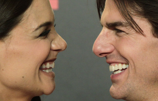 "FILE - Actor Tom Cruise and his wife Katie Holmes pose during a photo-call for the world premiere of their new film ""Knight and Day"" at the Lope de Vega theatre in Seville, Spain on Wednesday June 16, 2010. Cruise and Homes are calling it quits after five years of marriage. Holmes' attorney Jonathan Wolfe said Friday June 29, 2012 that the couple is divorcing, but called it a private matter for the family. (AP Photo/Toni Rodriguez)"