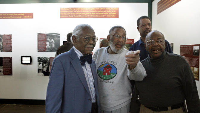 "ADVANCE FOR USE SUNDAY, FEB. 8 - In this photo taken Tuesday, Feb. 3, 2015, frm left, Rev. Clinton Scott, 93, of Roanoke,John Mease., 71, of Salem,  Paul Washington, 83, of Roanoke, and Phillip Randolph, 53, of Roanoke, 53, look at portraits of fellow railroad workers on display in the ""From Cotton to Silk, African American Railroad Workers of the Norfolk & Western and Norfolk Southern Railways' exhibit at the Virginia Museum of Transportation in Roanoke, Va. All worked for the railroad. (AP Photo/The Roanoke Times, Heather Rousseau)  LOCAL TELEVISION OUT; SALEM TIMES REGISTER OUT; FINCASTLE HERALD OUT;  CHRISTIANBURG NEWS MESSENGER OUT; RADFORD NEWS JOURNAL OUT; ROANOKE STAR SENTINEL OUT"