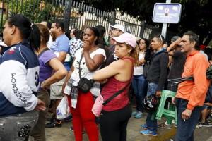 People queue outside a state-run Bicentenario supermarket…