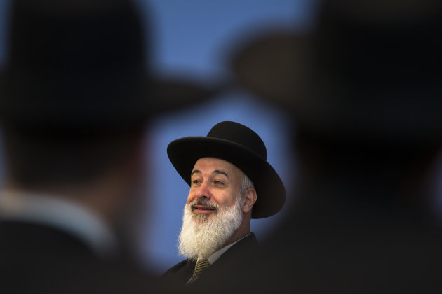 Ashkenazi Chief Rabbi of Israel Yona Metzger briefs the media at the Federal Press Conference organization in Berlin, Tuesday, Aug. 21, 2012. Israel's chief rabbi is in Germany for talks aimed at smoothing over controversy over the legality of circumcising young boys. German lawmakers have called for the government to draft a law this fall explicitly permitting 'medically correct circumcision'. That call came after a Cologne court concluded in June that circumcision amounts to bodily harm. (AP Photo/Markus Schreiber)