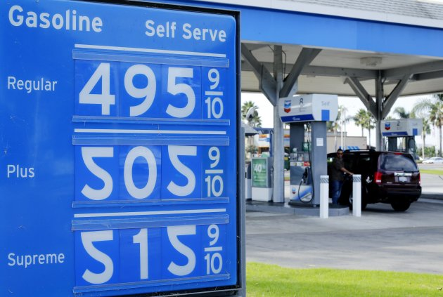 A gas station uses upside-down number 2's as 5's to display prices of gasoline, which has jumped over five dollars a gallon, in Carlsbad, California October 5, 2012. California gas prices rose 17 cents a gallon overnight due to supply disruptions at some refineries and seasonally low inventories, bringing the one-week increase in the Golden State to nearly 36 cents. REUTERS/Mike Blake  (UNITED STATES - Tags: TRANSPORT ENERGY BUSINESS)
