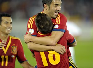 Spain's Jordi Alba, back to camera no. 18, celebrates …