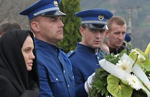 Hollywood actress Angelina Jolie (L) pays her respects …