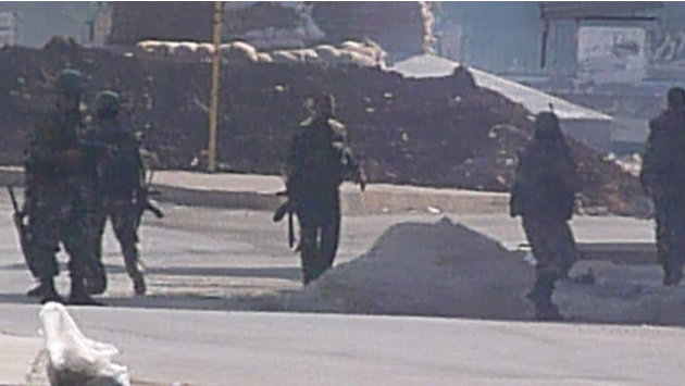 Soldiers are seen at an army checkpoint in Hula