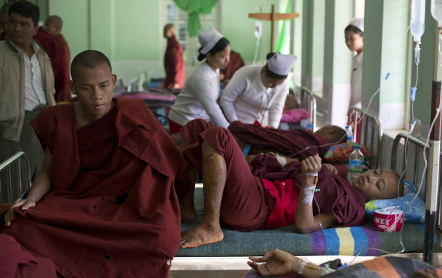 Buddhist monks with burn injuries are treated at a hospital in Monywa, northwestern Myanmar, Thursday, Nov. 29, 2012. Security forces cracked down on protesters occupying a copper mine early Thursday, using water cannons and other devices to break up the rally hours before opposition leader Aung San Suu Kyi was expected to hear their grievances. Unexplained fires engulfed the protest camps at the Letpadaung mine in northwestern Myanmar and dozens of Buddhist monks and villagers were injured, according to several protesters. (AP Photo/Gemunu Amarasinghe)