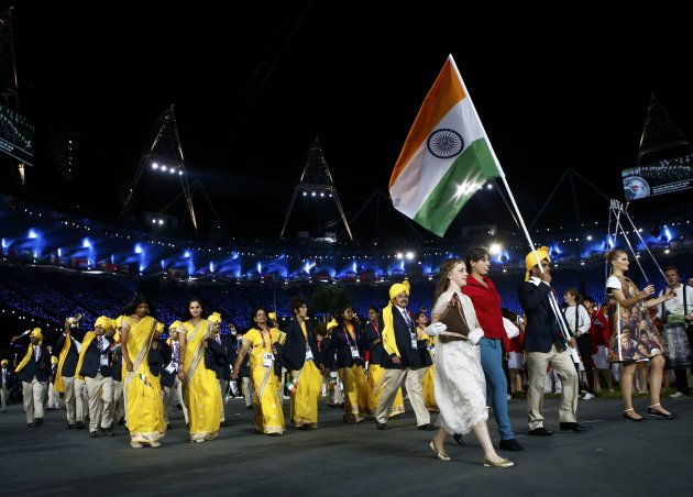 India's flag bearer Sushil Kumar holds the national flag during the opening ceremony of the London 2012 Olympic Games