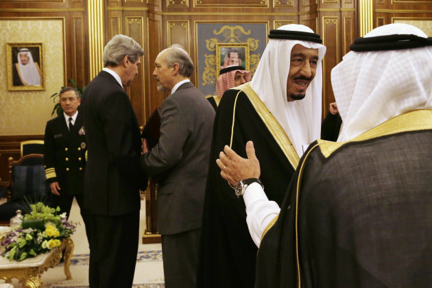Saudi Deputy Foreign Minister Prince Abdulaziz bin Abdullah, second from right, is greeted as U.S. Secretary of State John Kerry, second from left, speaks with an advisor before the start of their meeting at Yamamah Palace in Riyadh, Saudi Arabia on Monday, March 4, 2013. Saudi Arabia is the seventh leg of Kerry's first official overseas trip. (AP Photo/Jacquelyn Martin, Pool)