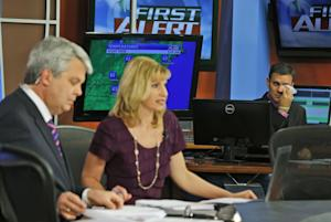 WDBJ-TV7 meteorologist Leo Hirsbrunner, right, wipes …