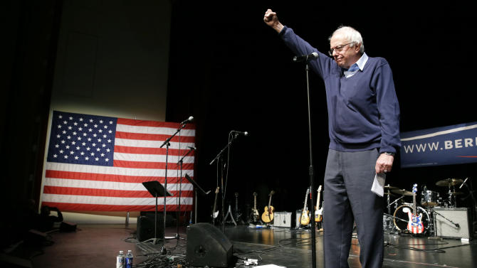 Democratic presidential candidate, Sen. Bernie Sanders, I-Vt., reacts to supporters during a concert hosted by his campaign Friday, Oct. 23, 2015, in Davenport, Iowa. (AP Photo/Charlie Neibergall)