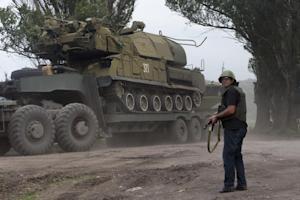 FILE - In this Friday, July 4, 2014 file photo, Ukrainian…